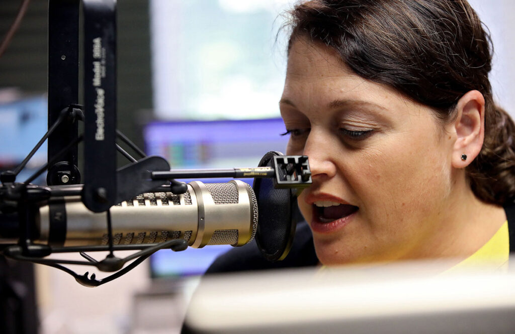 Margie Wiley records the stock market repot at the WXGM radio station in Gloucester