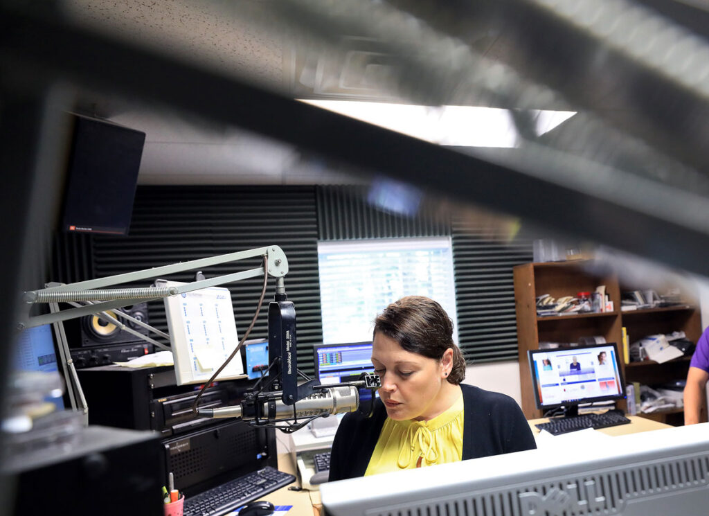Margie Wiley records the stock market repot at the WXGM radio station in Gloucester Monday September 21, 2020.