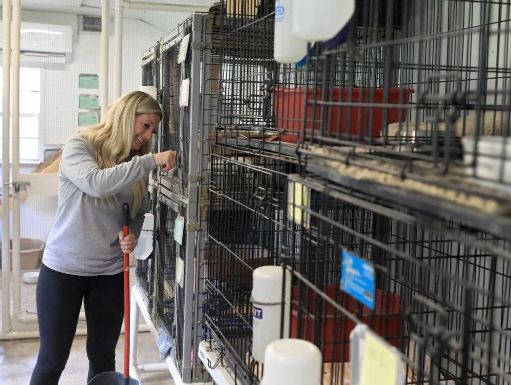 Margie Wiley and her adopted dog at the Suffolk Humane Society Wednesday April 28, 2021.